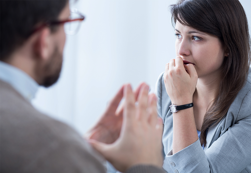 Image of two people in discussion about Mental Health in the workplace
