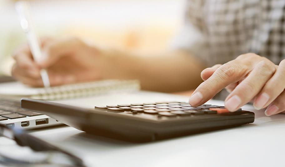 A man using a calculator.
