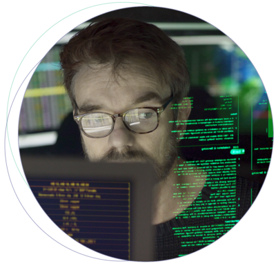 A man looking into a piece of code.