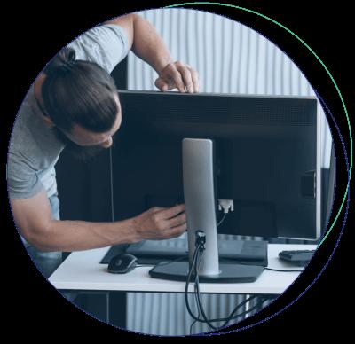 Man setting up a monitor.