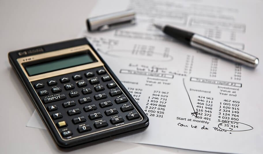 Calculator and document with business information.