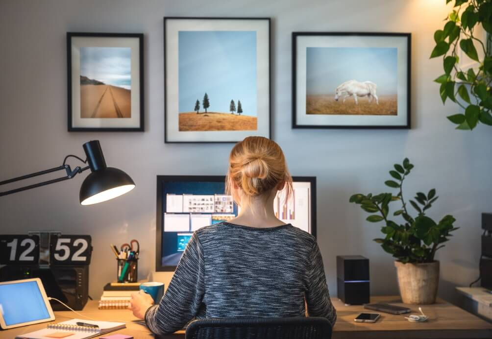 Woman sitting down and working from home.